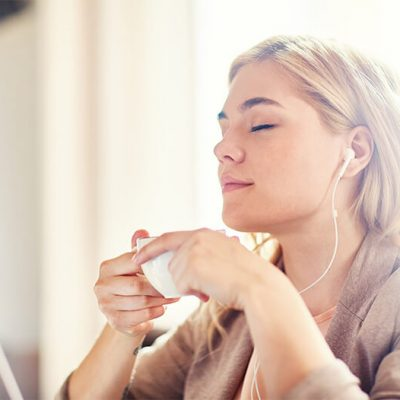Young woman relaxing with headphones