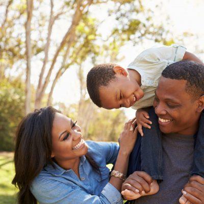 Happy family of three outdoors