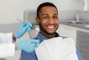 male patient smiling during a dental checkup